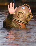 Lloyd Scott, 41, gives a final wave before submerging to begin his underwater marathon world record attempt to raise money for children with Leukemia, in Loch Ness, Scotland